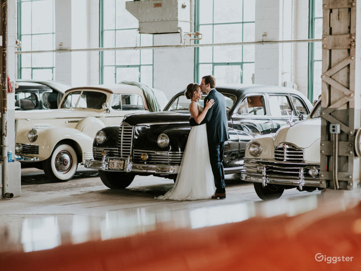 Packard Proving Grounds - wedding couple in the Tank Test building with classic Packard cars