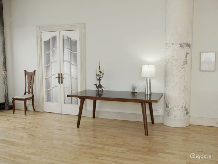 Large table in front of lighted French Doors.