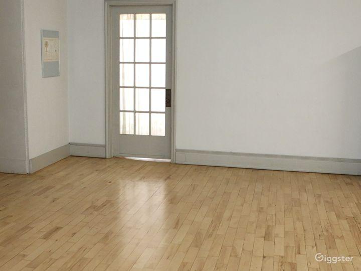 Working door in large, blank wall.