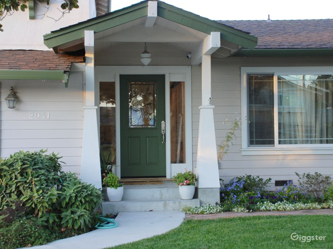 The front porch has Craftsman-style columns.