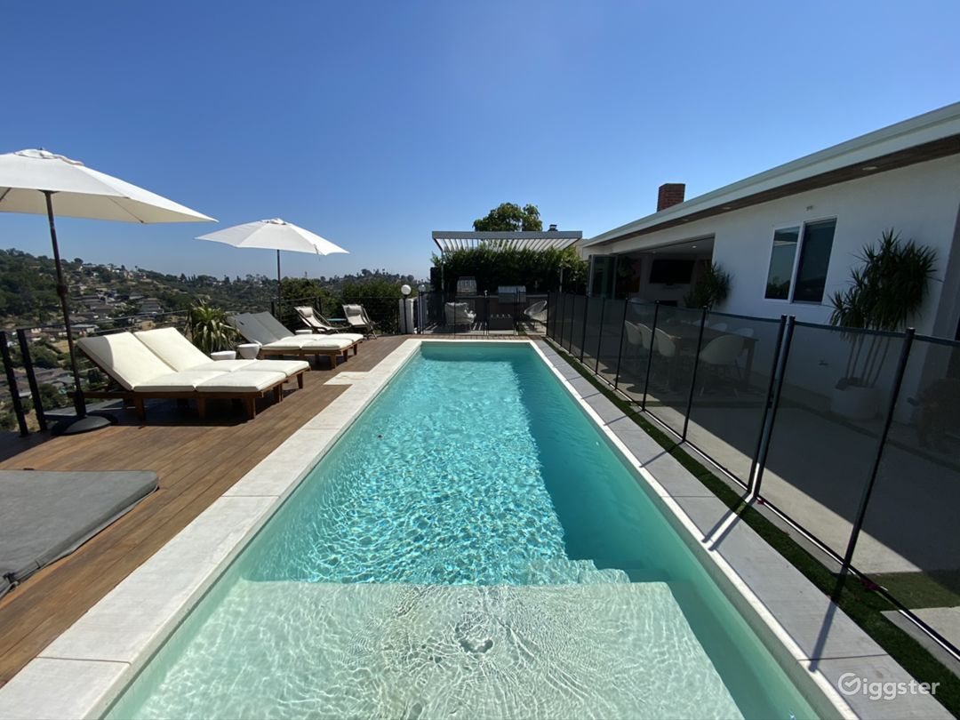 Modern Organic Hilltop Home with Pool and View Photo 3