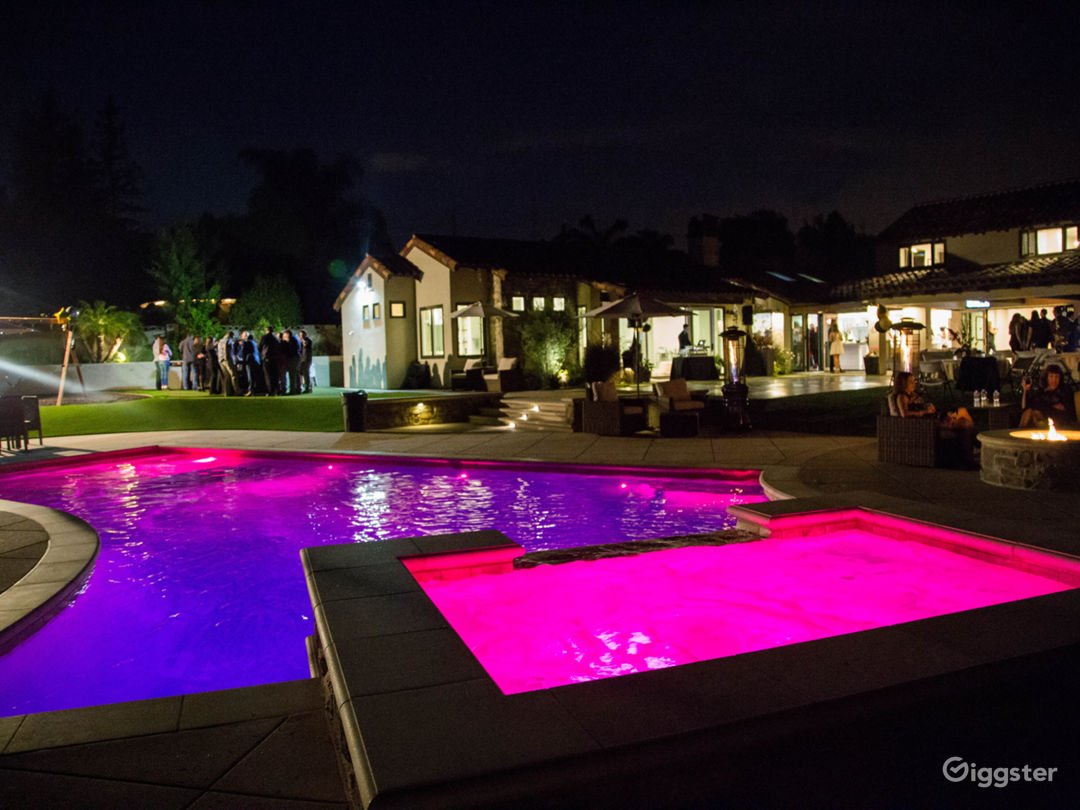 Night view from pool with many different lights adjust color in pool during party