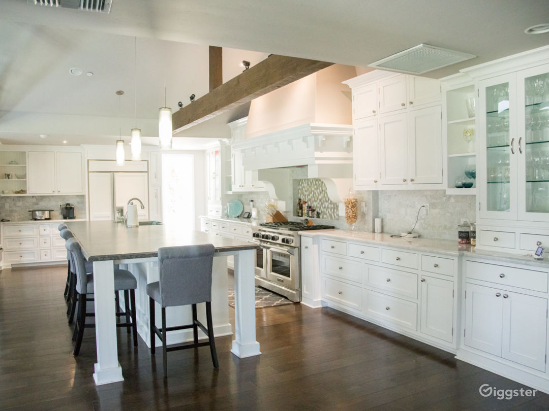 Great open kitchen with tons of light and great beams and marble island
