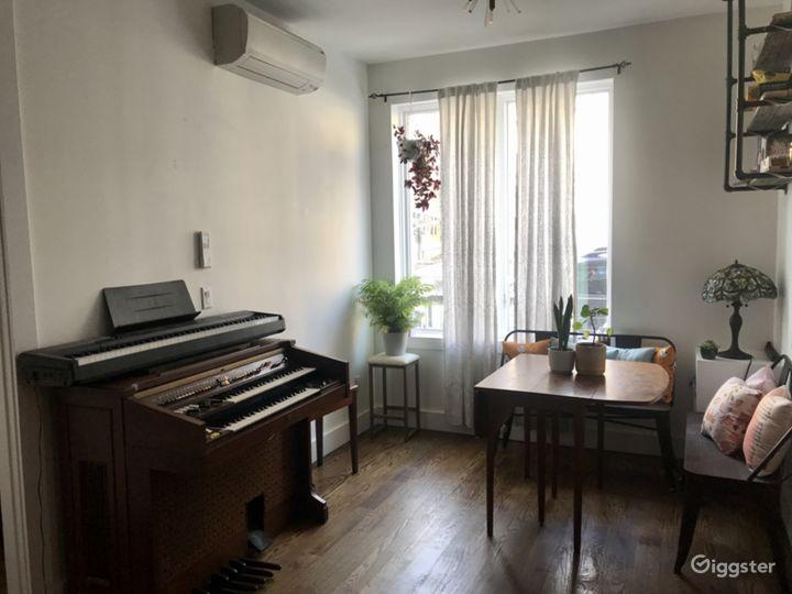 Vintage organ, keyboard, and sitting nook