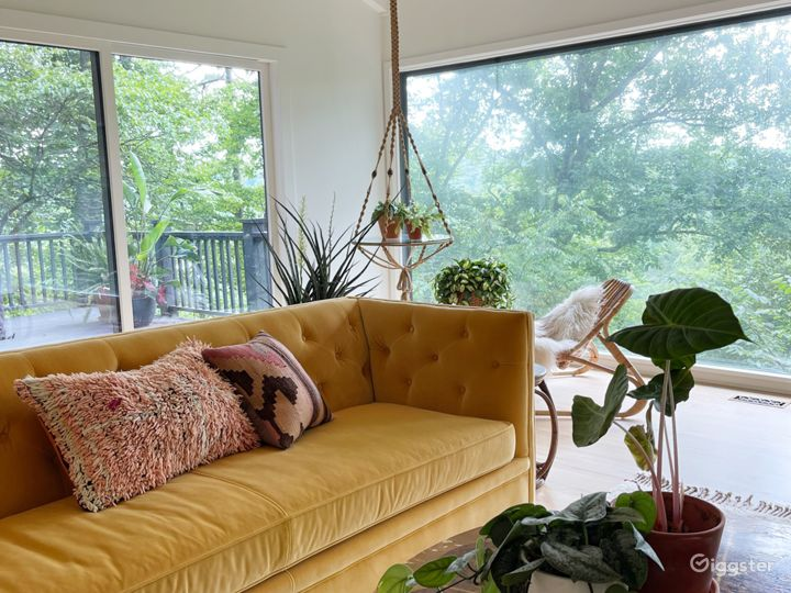 Living room floor to ceiling window and sliding glass door view. Full view of nature preserve and river.