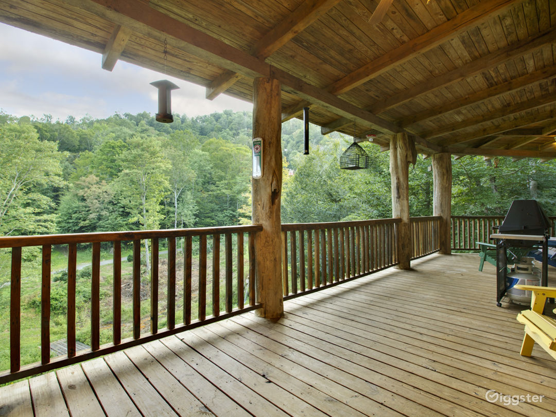 Relaz on the large wrap around porches overlooking 2 ponds