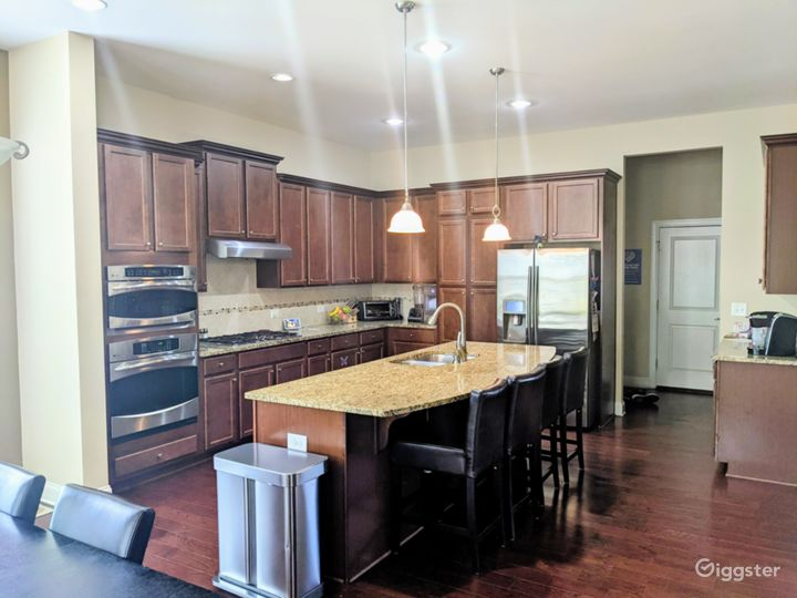 Large open kitchen with all stainless steel appliances