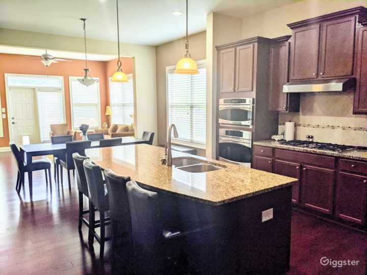 The kitchen opens to the breakfast area and sunroom