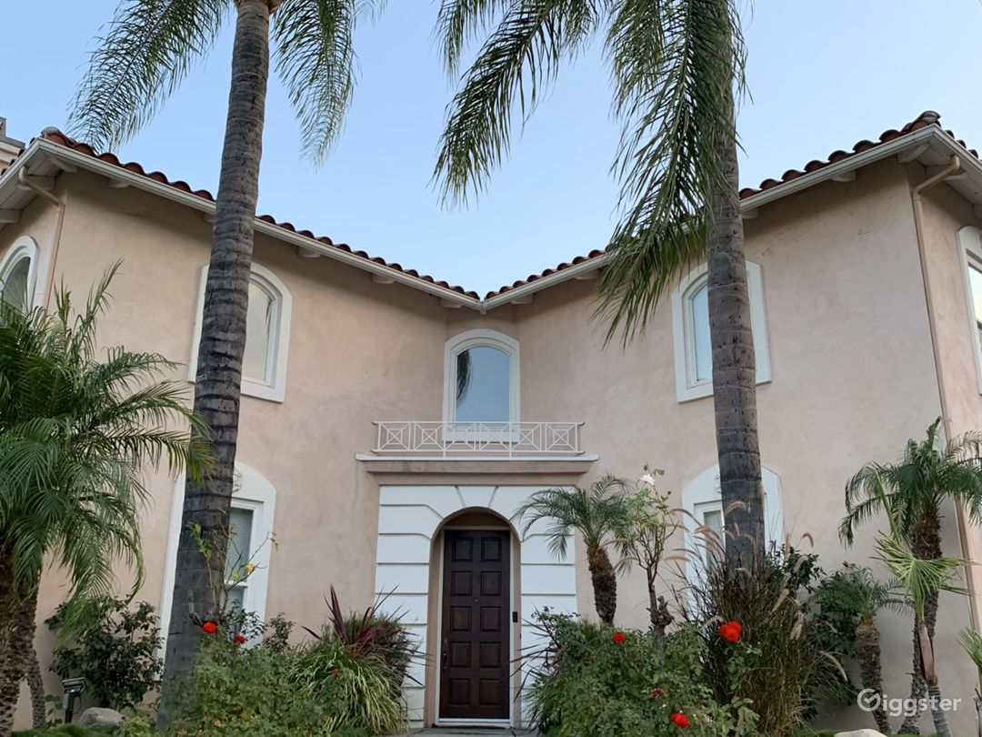 Front of our beautiful home with our variety of palm trees!