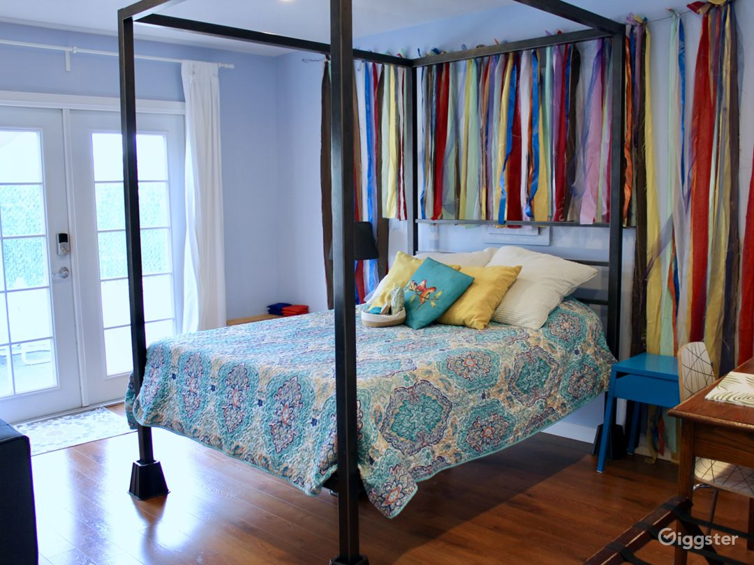 Full size bed with colorful backdrop. Backdrop can be removed.