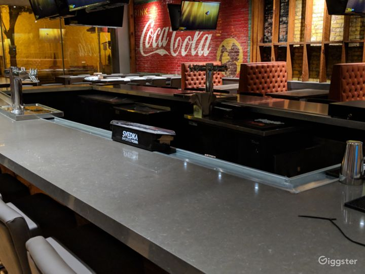 Another shot of the bar, large Coca-Cola mural in the background