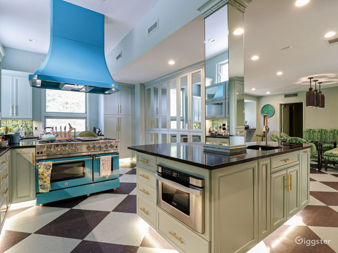 Turquoise and malachite period kitchen with colored appliances, harlequin floor, faux malachite backsplash