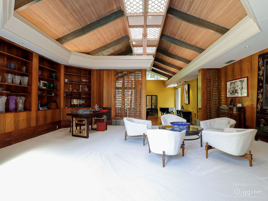 Elevated room with glass wall, crotched mahogany walls, coromandel screen, quatrefoil skylights, cypress ceiling