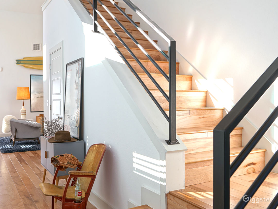 Staircase. Entire house is wood flooring.