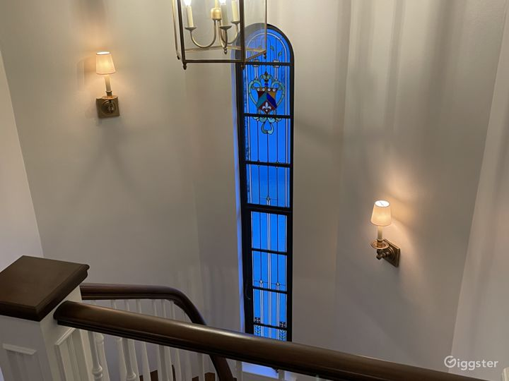 staircase with original stained glass window