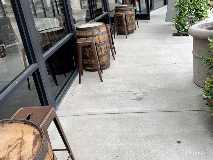 Barrels provide outdoor seating.