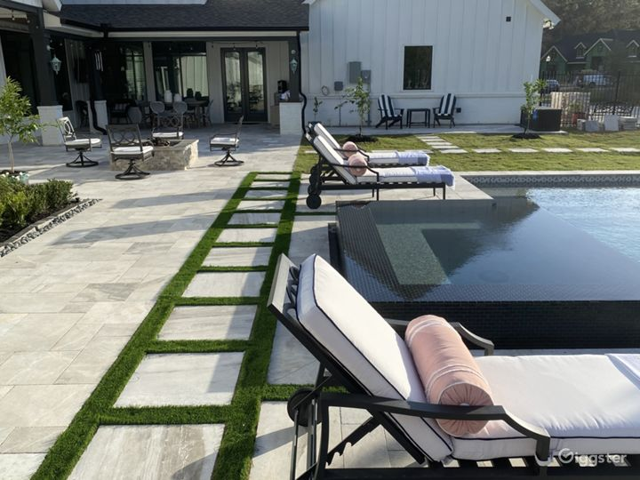 Pool and travertine decking in natural, private setting