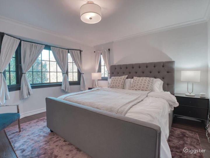 Master Bedroom with garden views through bay windows