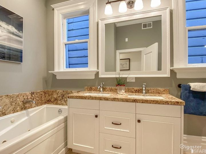 Double sink vanity with a large bathroom. Space for hair and makeup