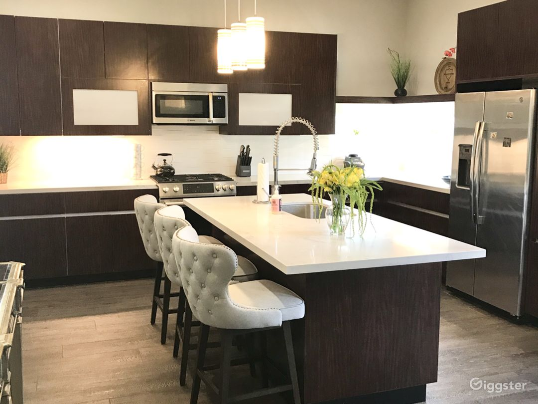 European style cabinets, quartz countertops, stainless Bosch appliances and a kitchen island large enough for 4!