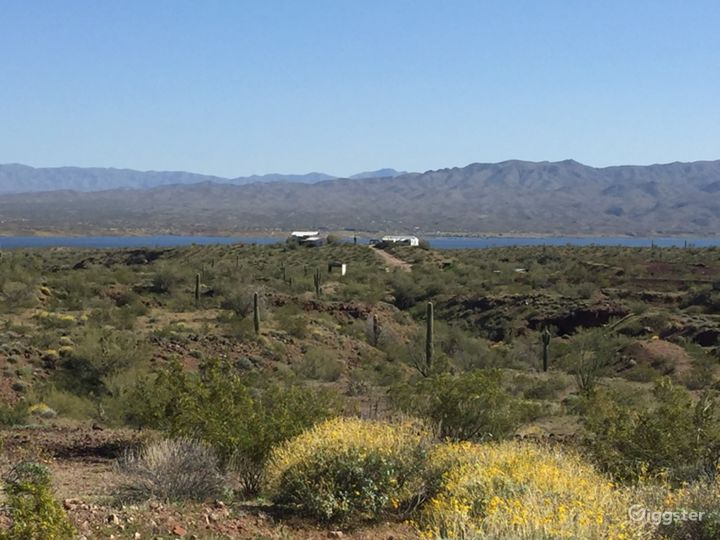 Two unrestored houses sit in a hill over looking Alamo Lake