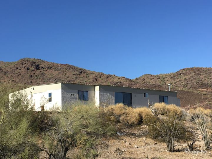 2500 sq foot cinderblock home has been updated with solar and restored