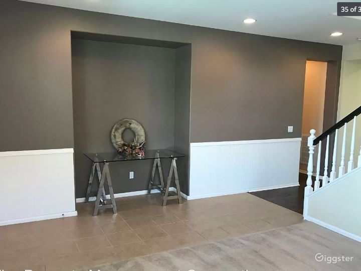 Entry way and formal living room (tile and carpeted)