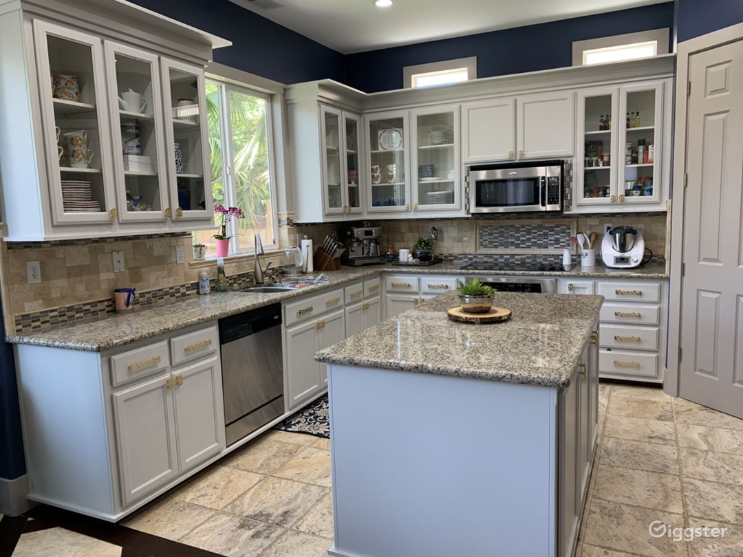 Kitchen with glass cabinets and gold accents