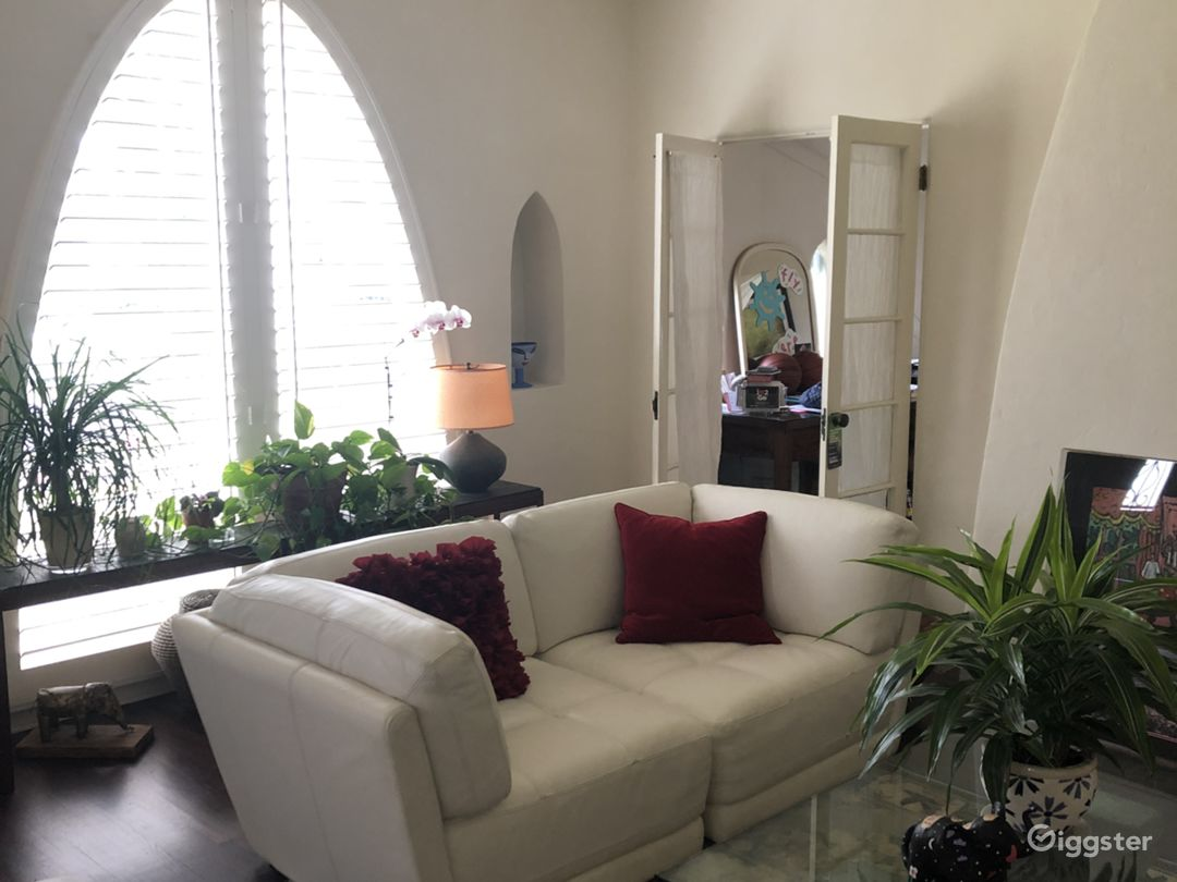 House was built in 1929 and is an original Spanish stucco home - updated 3 years ago but kept the original amenities, windows, and details for authentic charm.  Living room view from dining area/second living area.  Open door is an office area, not avail.