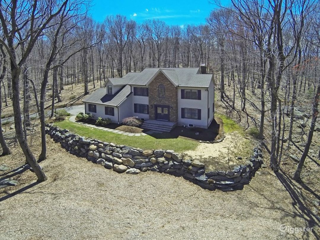 Large home nestled in the woods. Photo 1