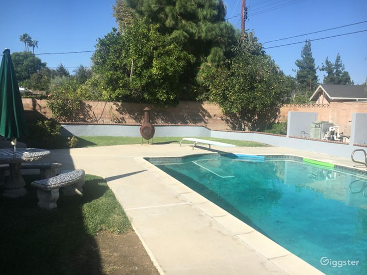 pool, diving board and fruit tree