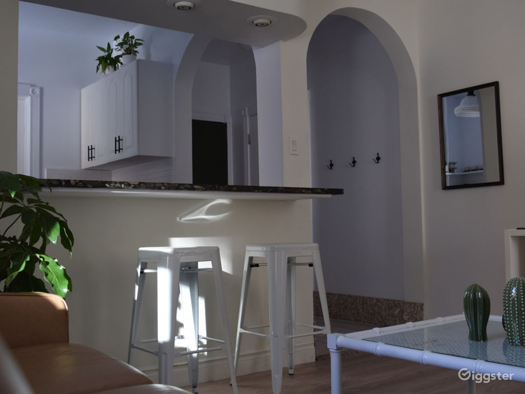 Living room with kitchen island and granite counter tops.