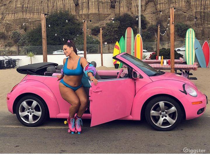 Ashley Graham shoot on beach for bikini brand.