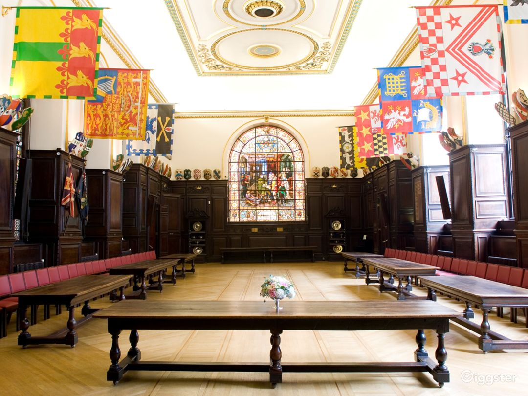16th Centaury wood-panelled dining room with ornate ceiling