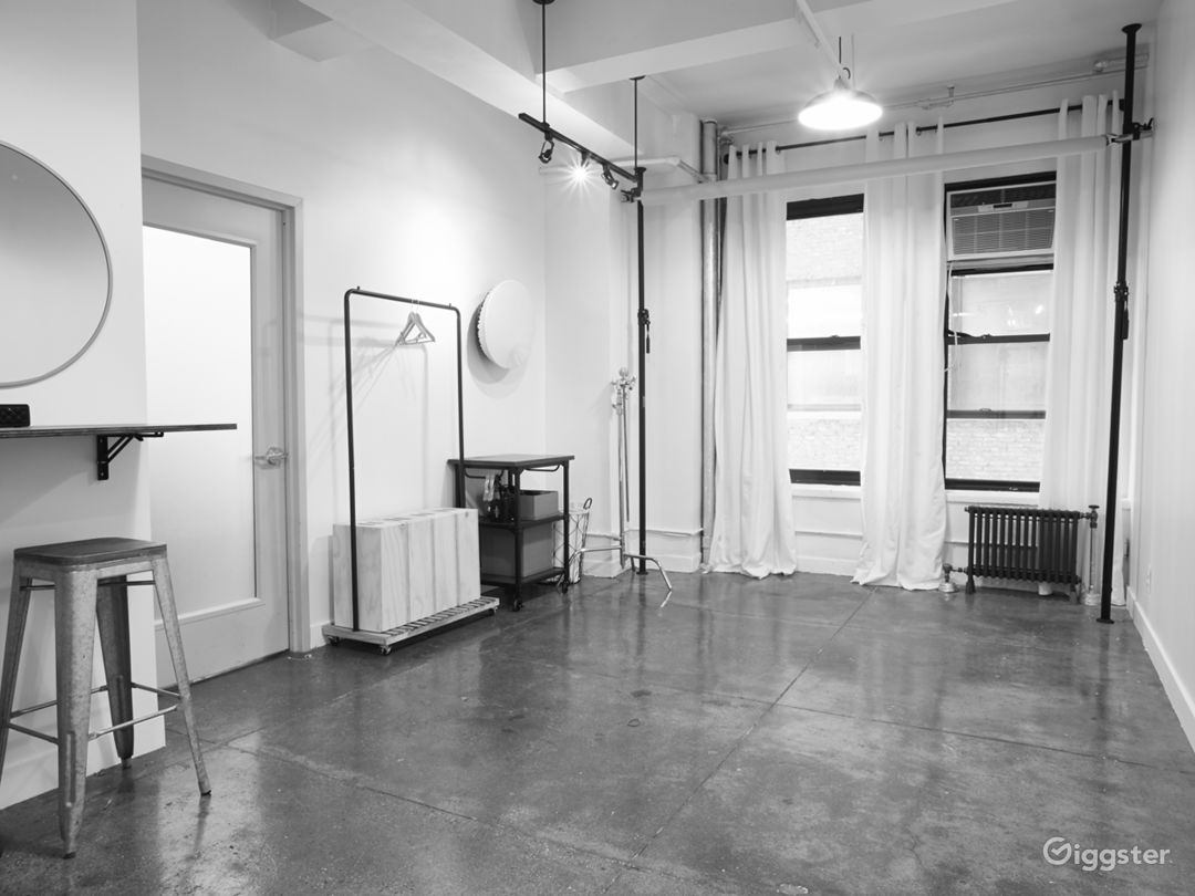 The space has concrete floors and two windows - come make it your own