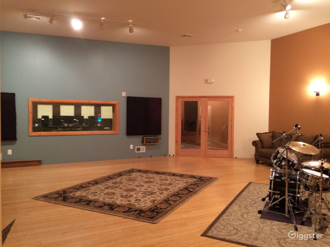 Live Room front wall with view of control room window and isolation room glass door