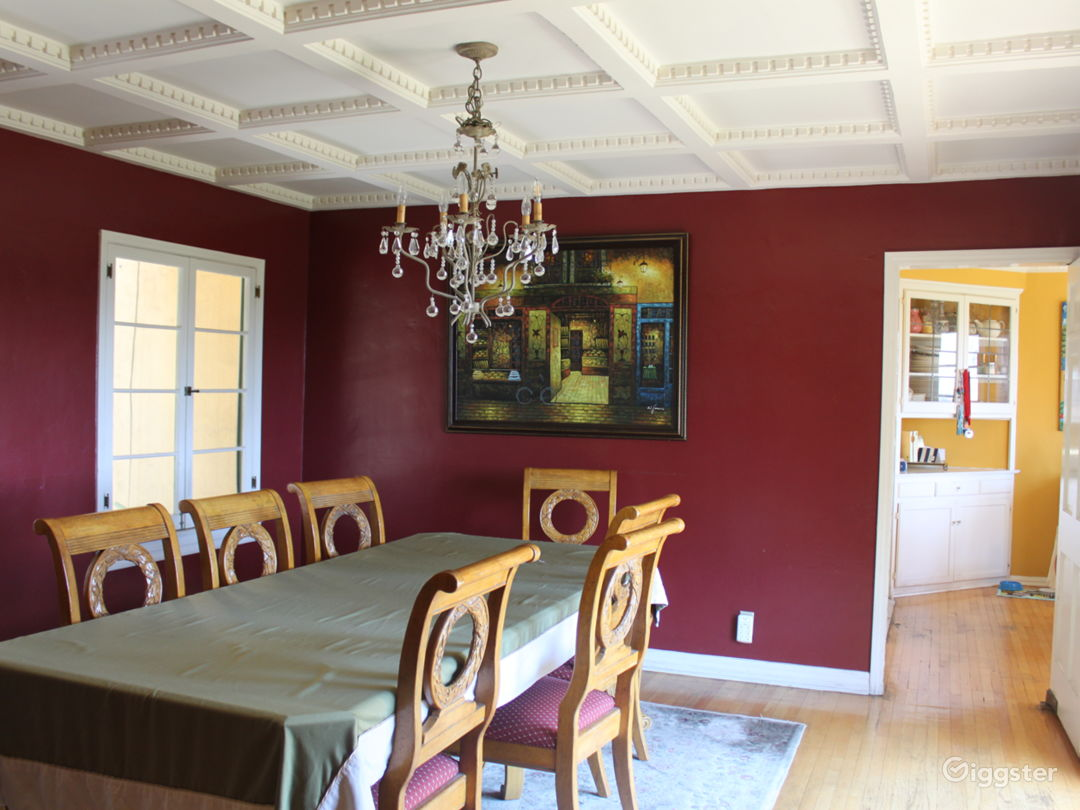 Dining room is elegant with view of the city, interesting unique architecture on ceiling, etc.