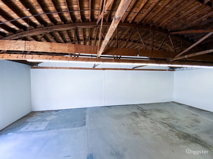 Clean white walls and concrete floor.