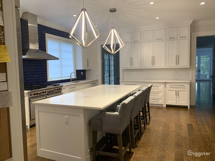 Eat-in kitchen with modern blue backsplash
