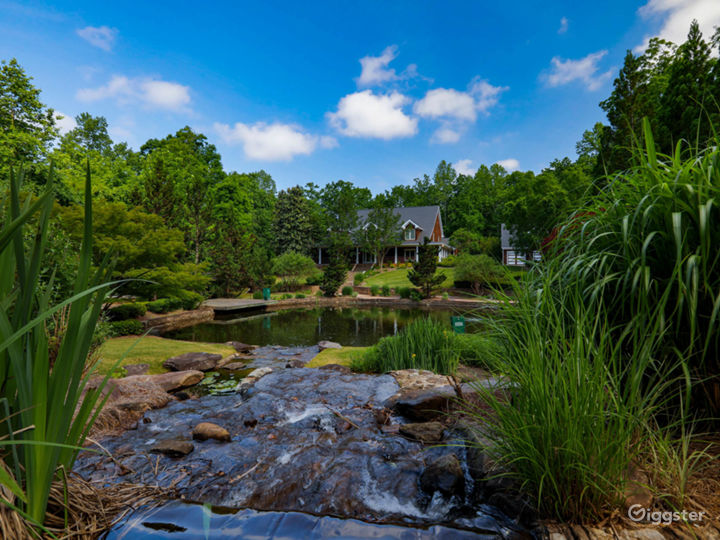 Lakeside Home with Scenic pond and waterfall Photo 2
