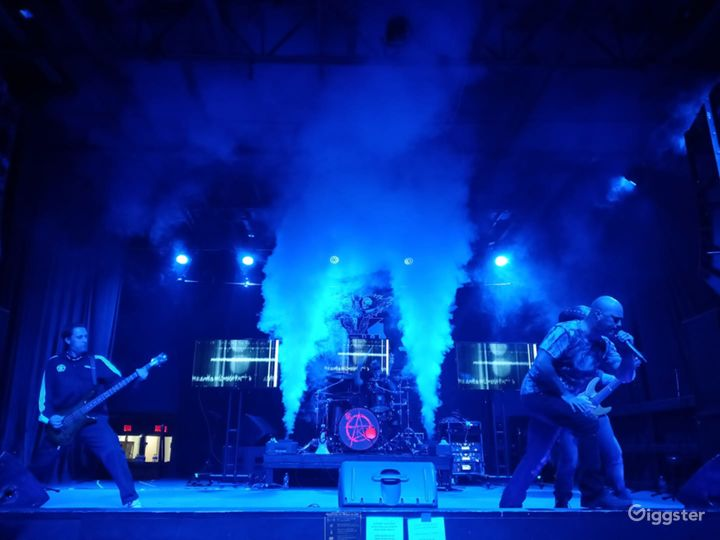 A Band doing what they do and putting on an not only incredible musical performance but also using visual lighting effects to bring home the mood of their performance.