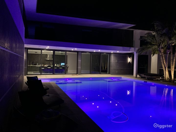 Pool lit house open at night