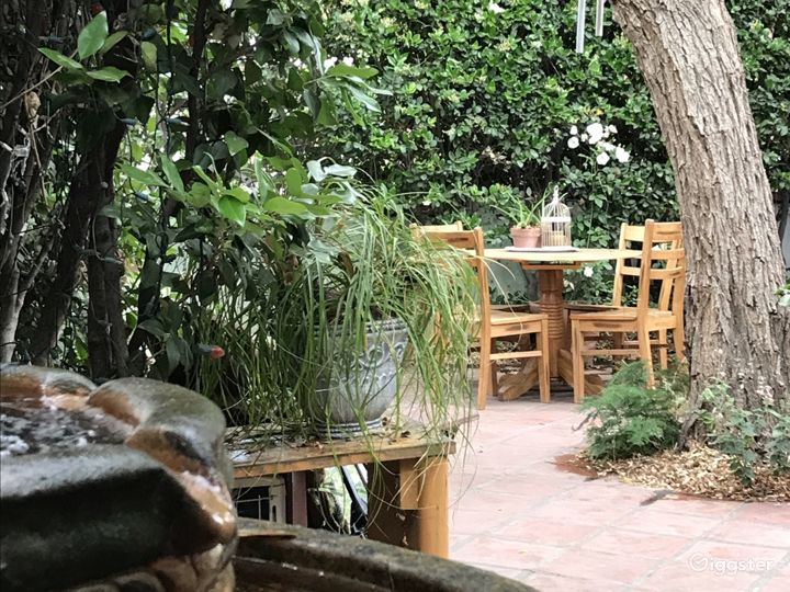 Patio includes an antique terra-cotta waterfall.