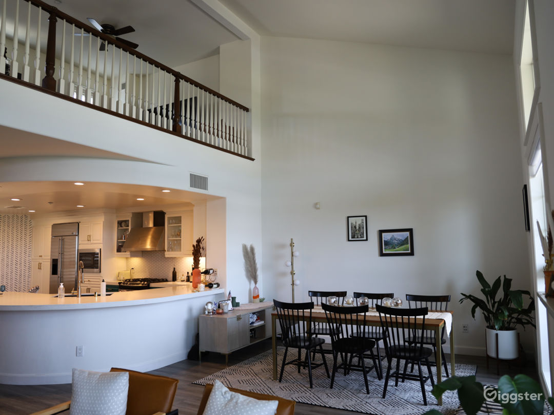 Living Room with view into Kitchen; Loft above
