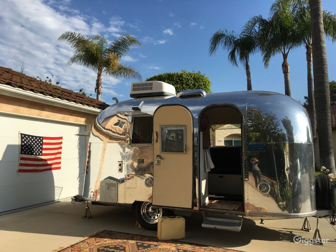 Rockin' 1965 Airstream Caravel super shiny on the outside, custom modern hollywood chic on the inside!