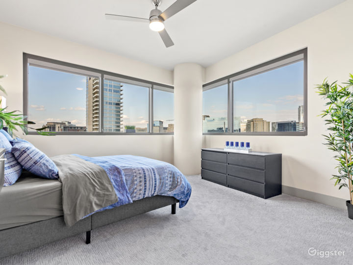 The bedroom has a panoramic view spanning from the American Airlines Center to the world famous Perot museum and all of the dallas skyline inbetween.