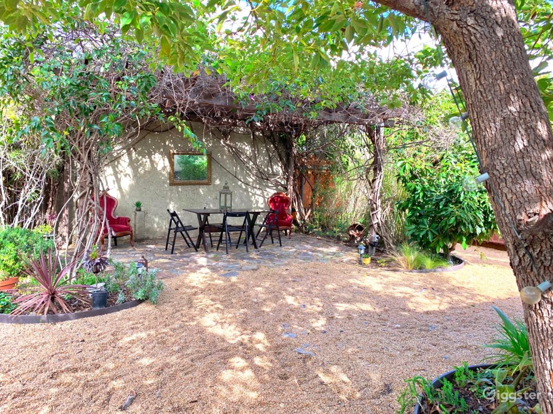 Enchanting Garden with Wisteria-Draped Pergola  Photo 2