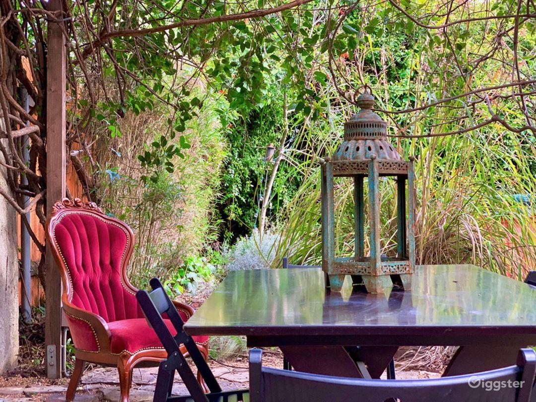 Enchanting Garden with Wisteria-Draped Pergola  Photo 1