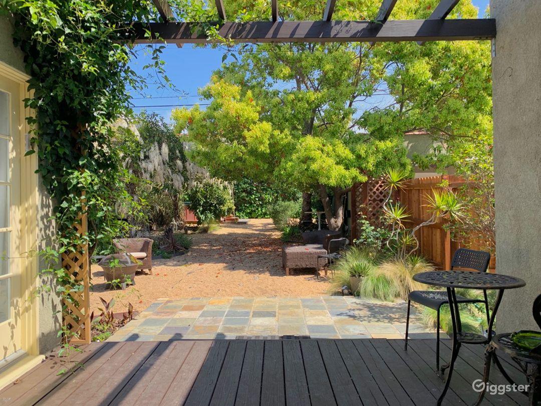 Enchanting Garden with Wisteria-Draped Pergola  Photo 5