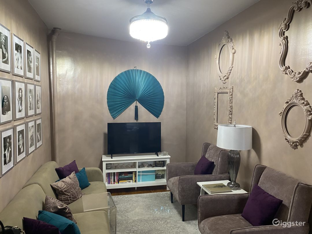 Living Room: Teal wall fan is easily removable